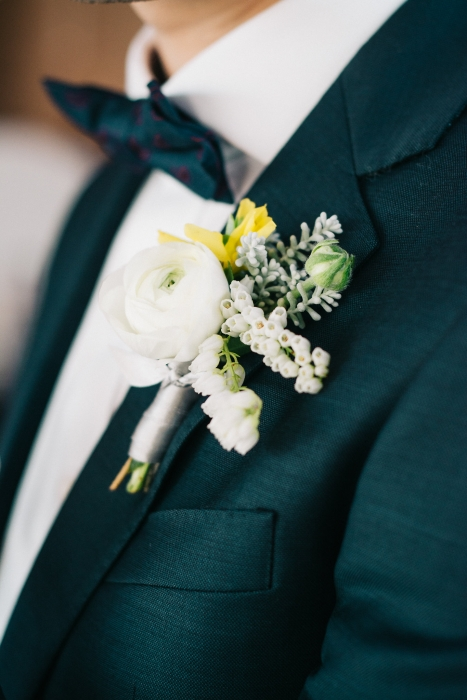 Ranunculus and pieris boutonniere}