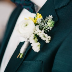 Ranunculus and pieris boutonniere